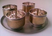 Четыре мельхиоровые чарочки на мельхиоровом подносе.